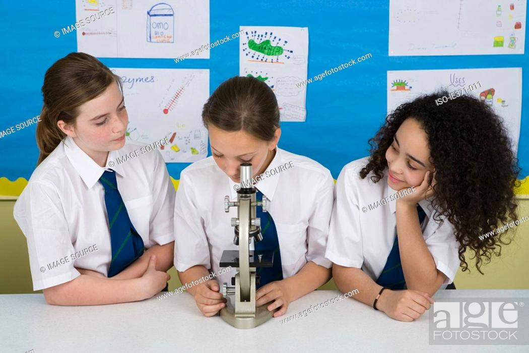 Stock Photo: Students with microscope.