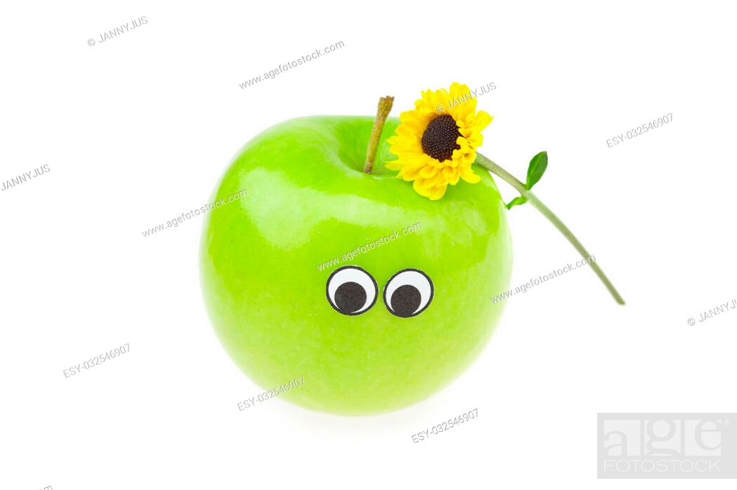 Imagen: joke apple with eyes and a flower isolated on white.