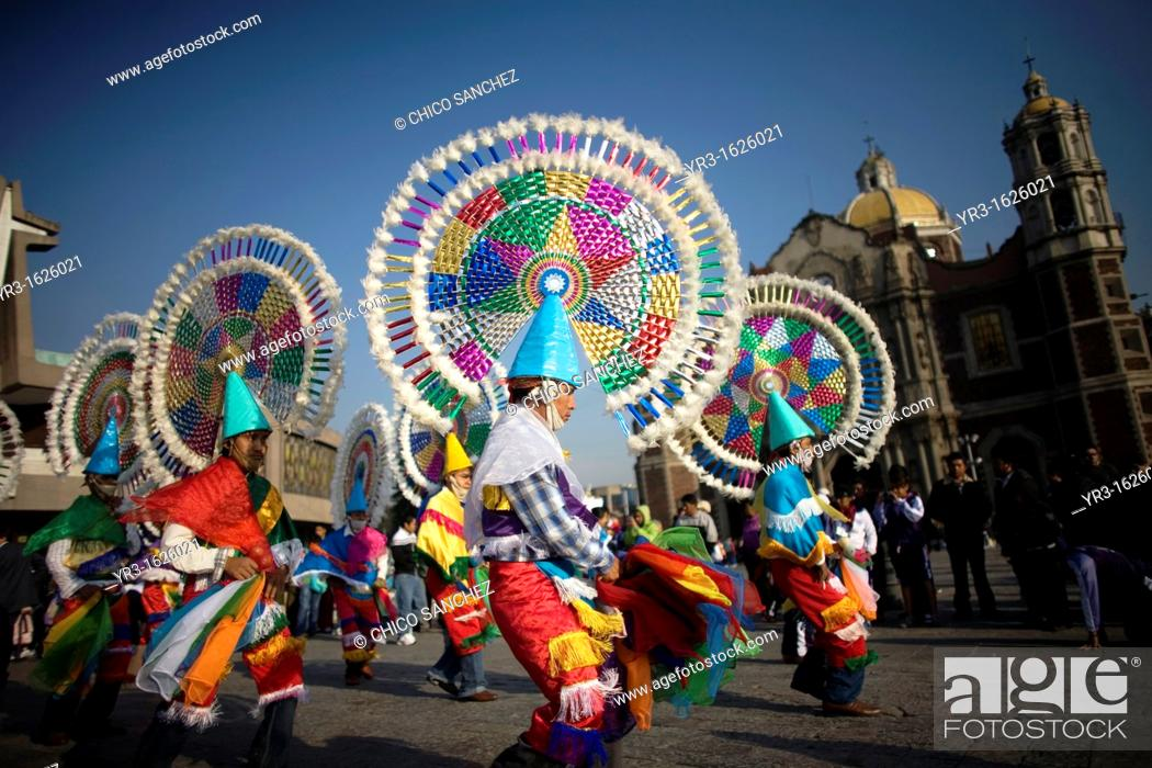 Stock Photo: Dancers from Huehuetla, Puebla state, perform the Quetzal dance outside the Our Lady of Guadalupe Basilica in Mexico City, December 10.