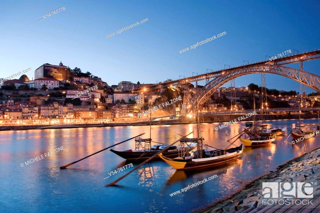 Stock Photo: Porto Wine Carrying Barcos Barges, River Douro and city skyline, Porto UNESCO World Heritage, Portugal.