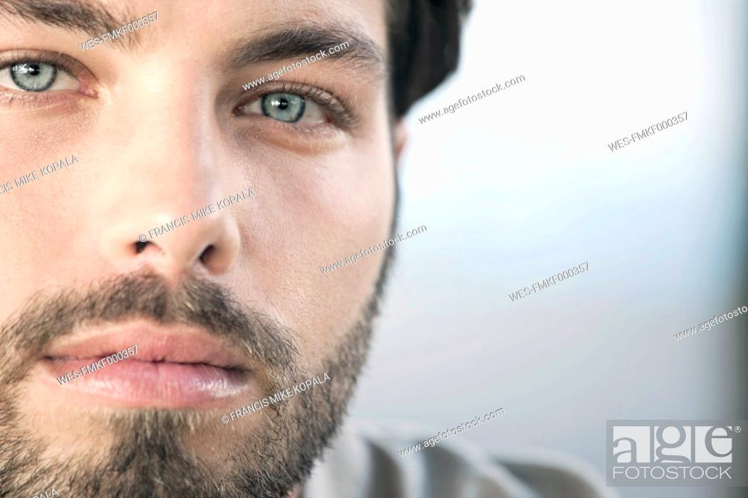 Stock Photo: Germany, Cologne, Portrait of young man, close up.