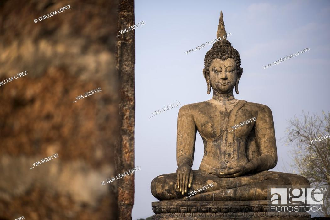 Stock Photo: Buddha statue at Wat Mahatat temple , Sukhothai Historical Park, Sukhothai, Thailand.
