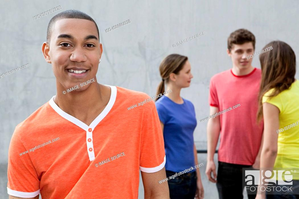 Stock Photo: Young man and friends.
