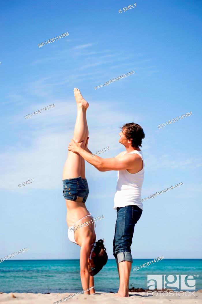 Stock Photo: couple on beach playing.