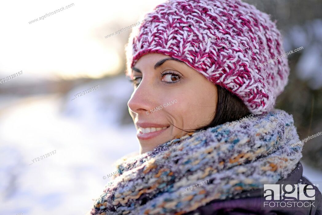 Stock Photo: Attractive young woman in winter environment.