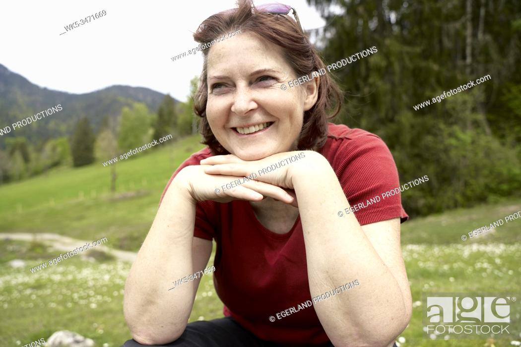 Stock Photo: Mature woman in countryside. Bad Tölz, Upper bavaria, Germany.