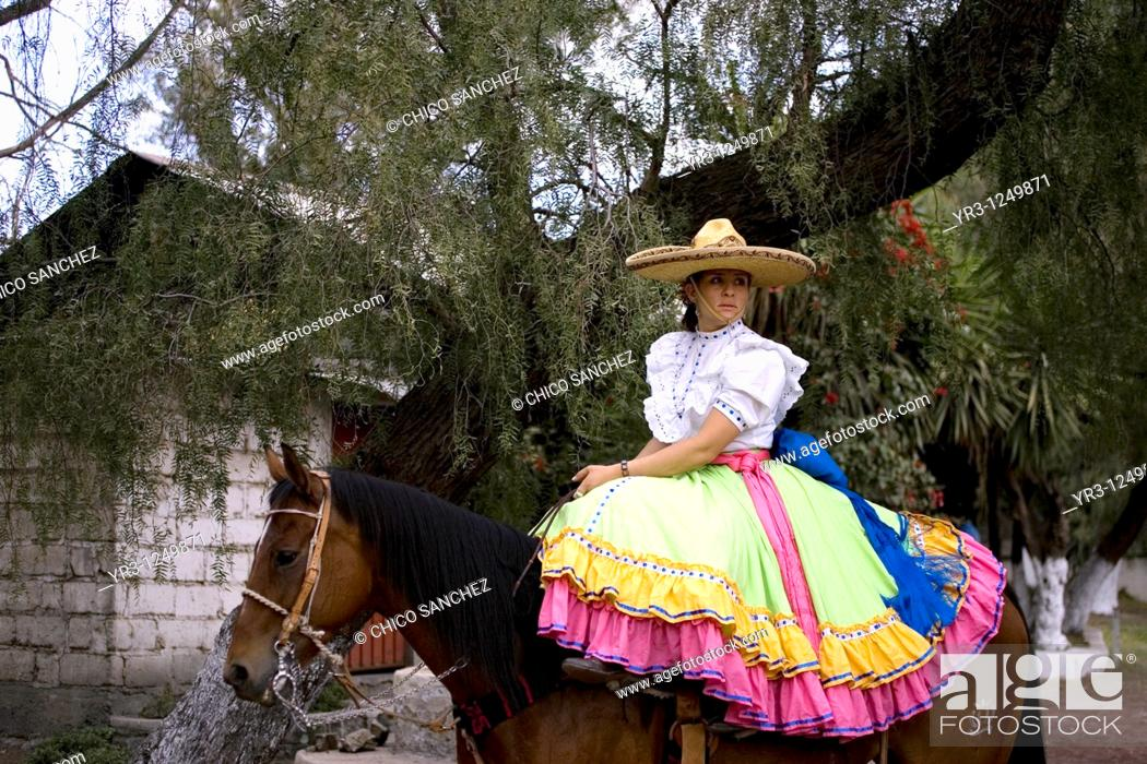 Stock Photo: A member of the El Herradero team sits on her horse before competing in an Escaramuza in Mexico City. Escaramuzas are similar to US rodeos.