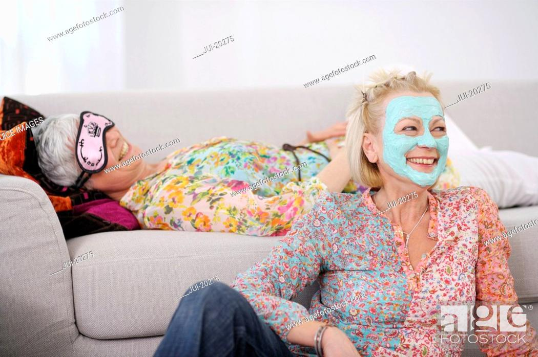 Stock Photo: Senior women pampering themselves and relaxing in living room.