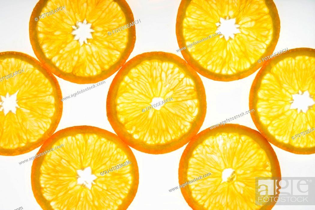 Stock Photo: Orange slices on white background.