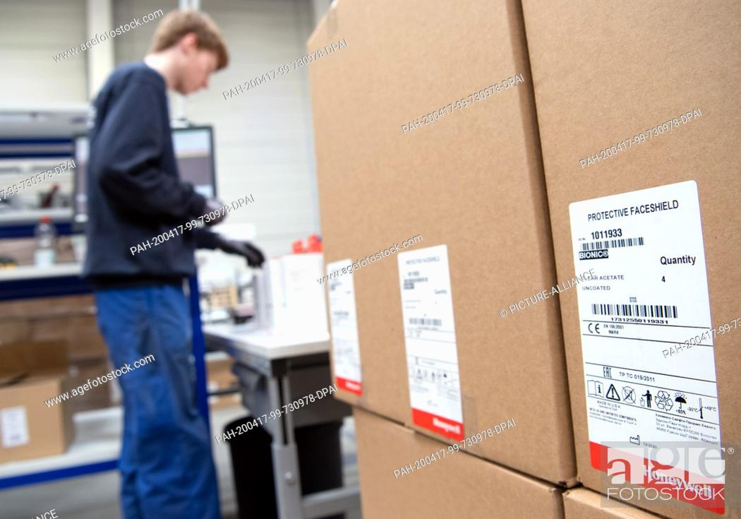 Stock Photo: 16 April 2020, Brandenburg, Großbeeren: Parcels with Protective Faceshild (protective masks) from Honeywell are available from the logistics service provider.