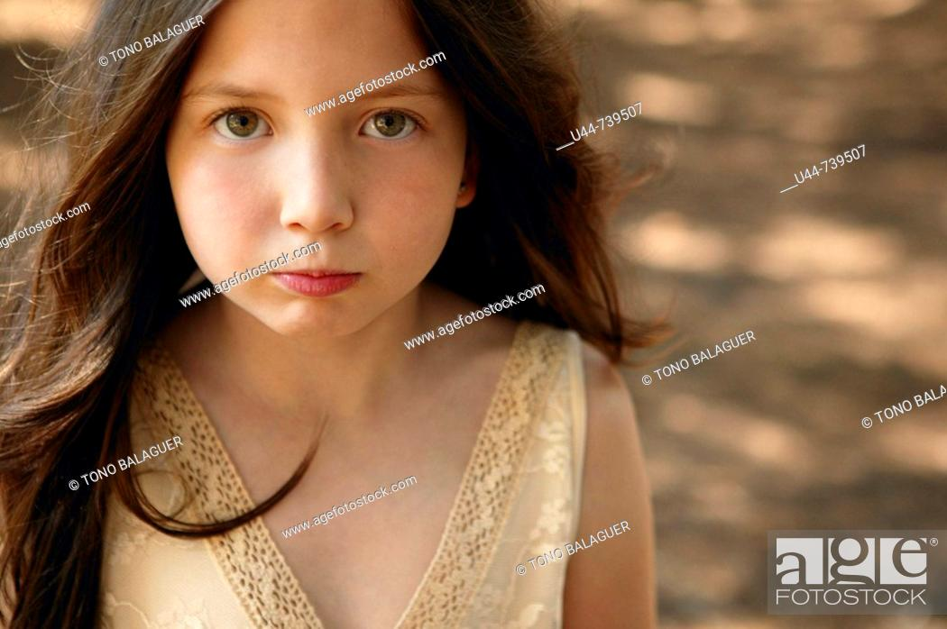 Stock Photo: One girl making funny expression.