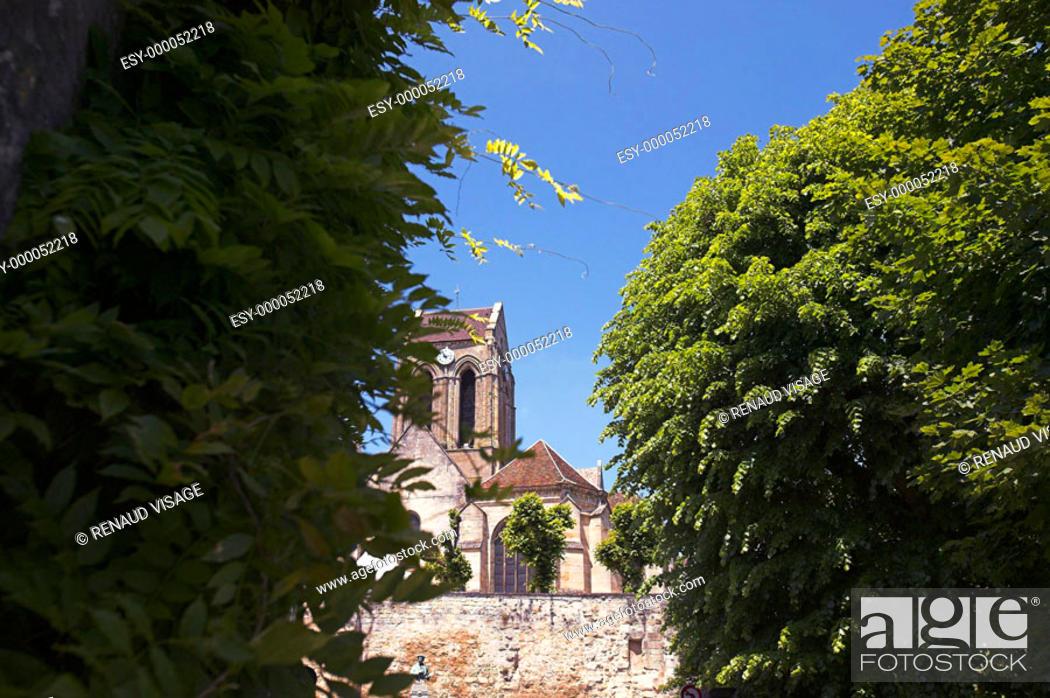 Stock Photo: View of church through trees. Auvers sur Oise. Ile-de-France. France.
