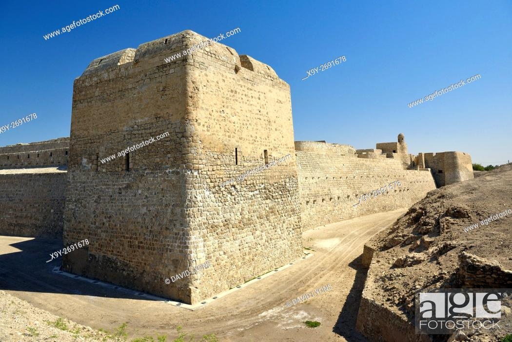 Stock Photo: Bahrain Fort dates from 2300 BC Copper and Bronze Ages. Once capital of Dilmun civilization. View south along the west wall.