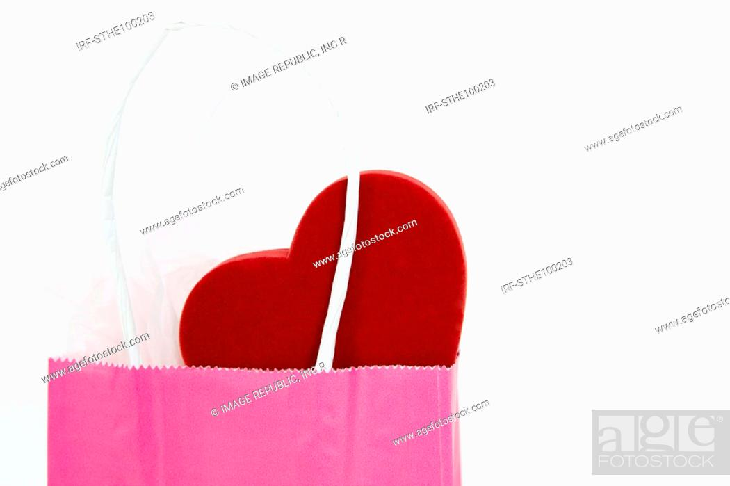 Stock Photo: heart shape in shopping bag.