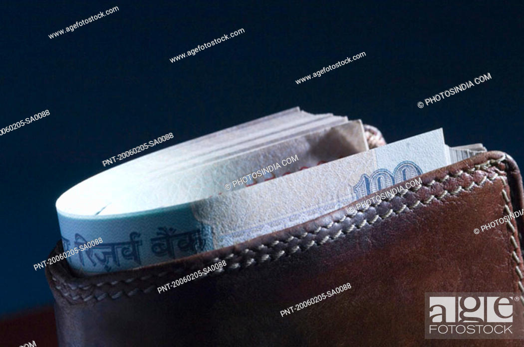 Stock Photo: Close-up of Indian one hundred rupee banknotes in a wallet.