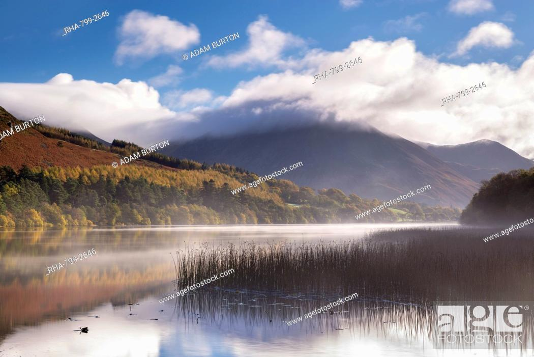 Stock Photo: Mist clears over Loweswater on a beautiful autumn morning, Lake District National Park, Cumbria, England, United Kingdom, Europe.