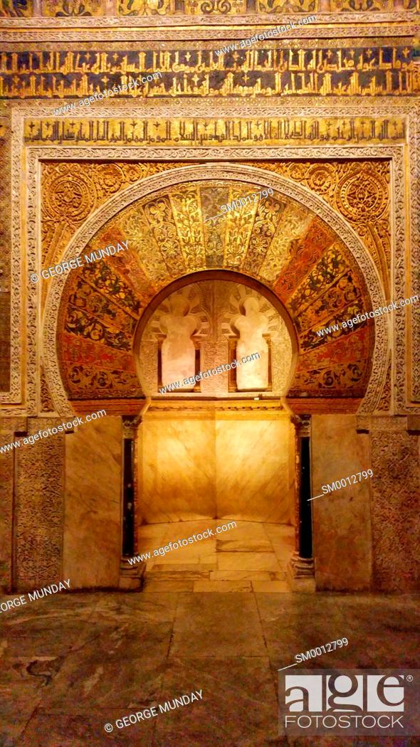 Stock Photo: The arched Mihrab or prayer niche used to identify the wall that faces Mecca,. The Prayer Hall in the 10th Century Mezquita Mosque, Cordoba City,.