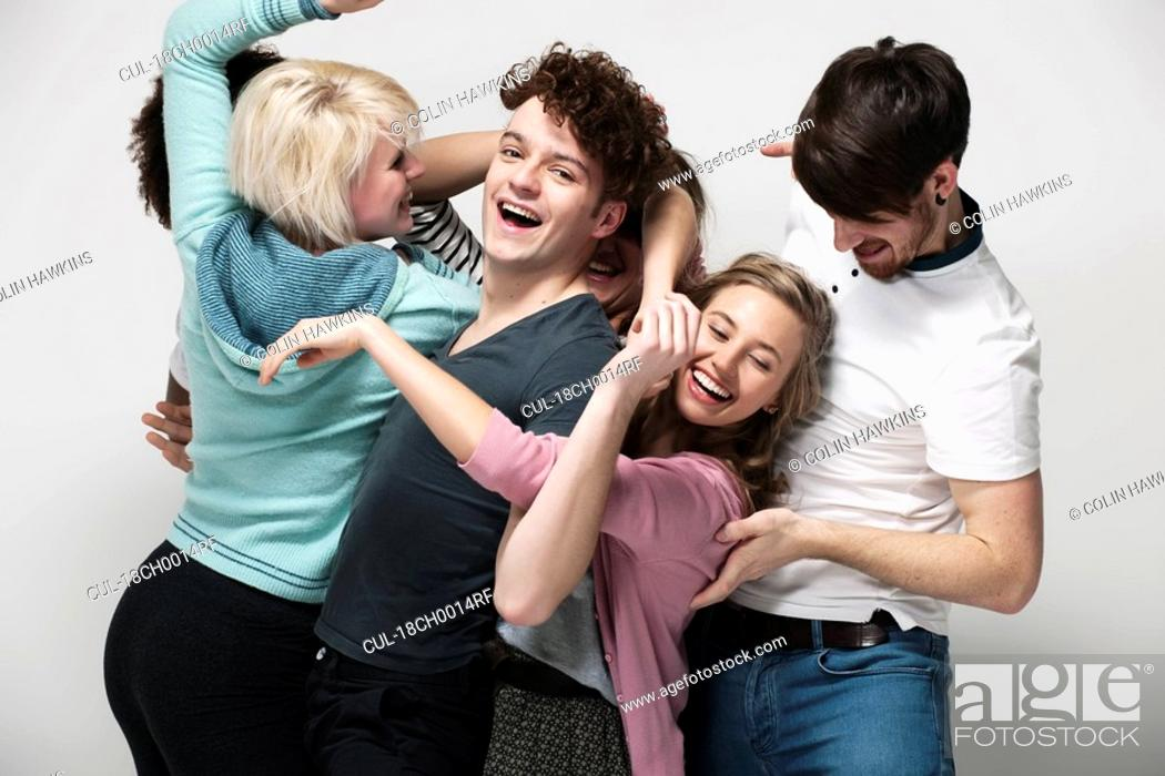Stock Photo: Interconnected group of young adults.