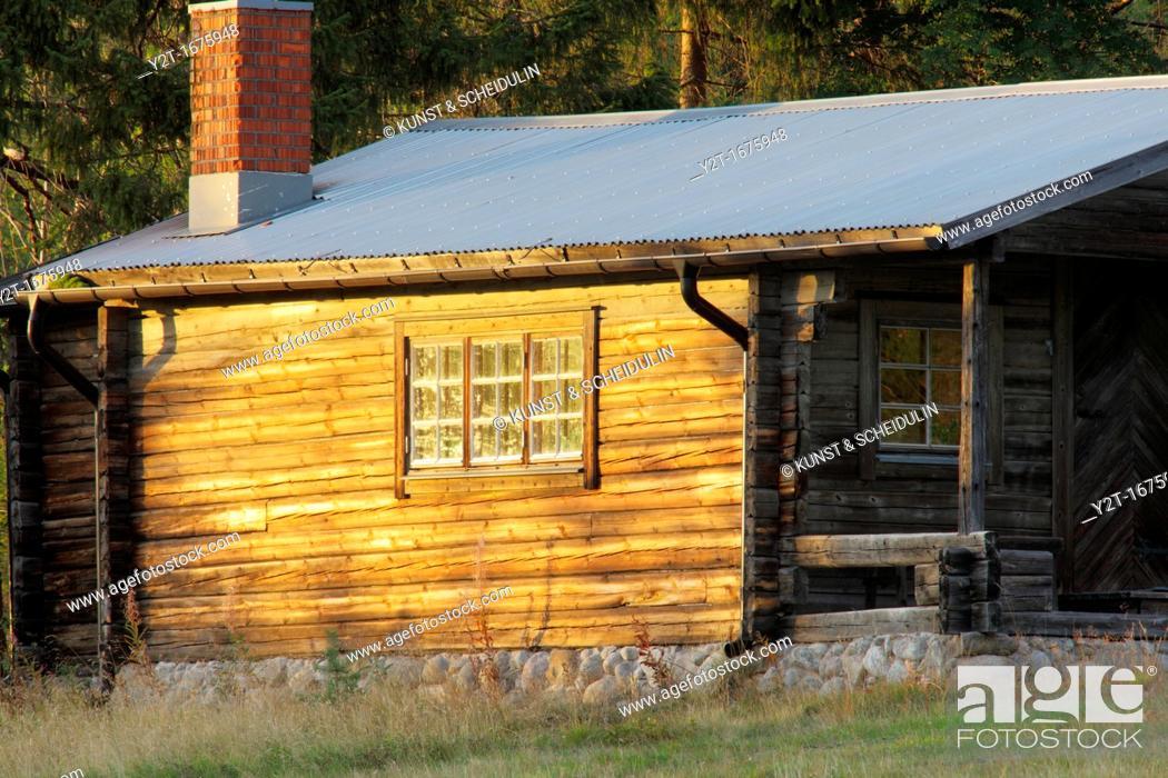 Stock Photo: Blockhouse bathing in evening sun  Vaesternorrland, Sweden.