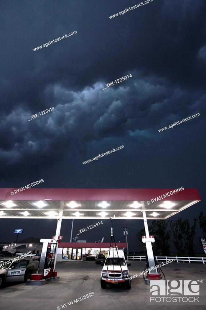 Stock Photo: A Project Vortex 2 storm chaser waits out a squall line beneath a gas station awning in Nebraska, May 24, 2010.