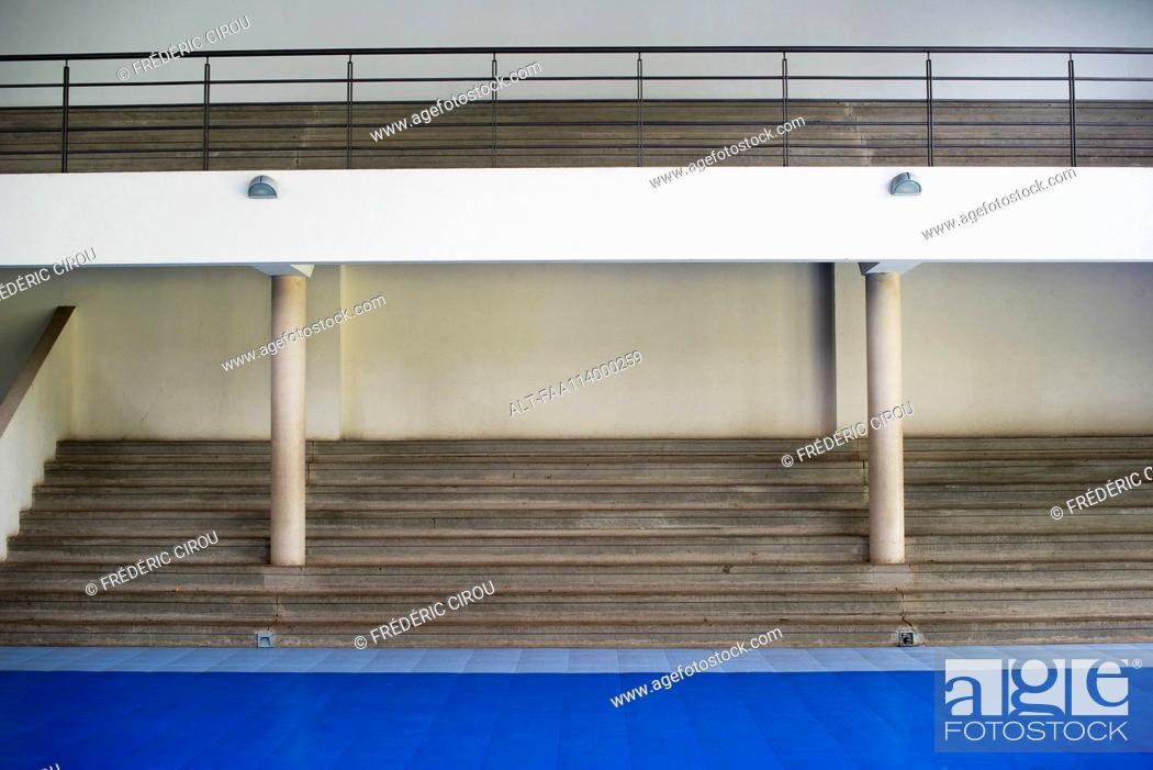 Stock Photo: Bleachers in empty gymnasium.