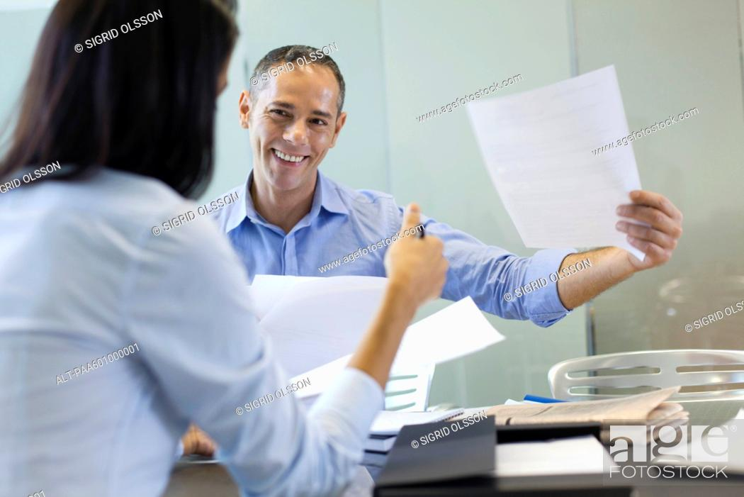 Stock Photo: Businessman working with colleague.