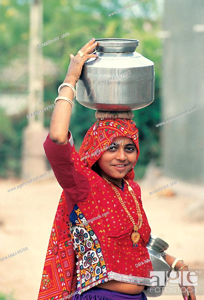 Stock Photo: Trible Women Carring Water , Saurashtra , Kutch , Gujrat , India.