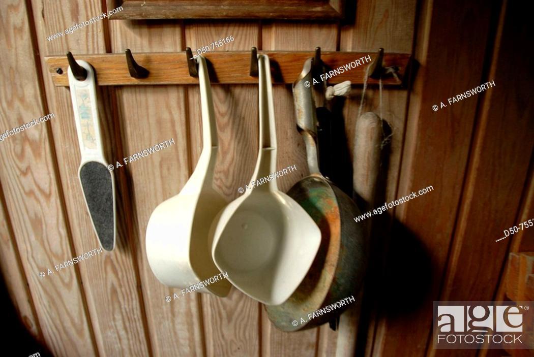 Stock Photo: Utensils hanging in a cabin: ladle, file. Gotland, Sweden.