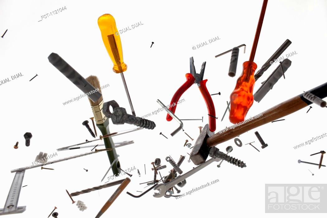 Stock Photo: Hand tools and equipment against a white background.