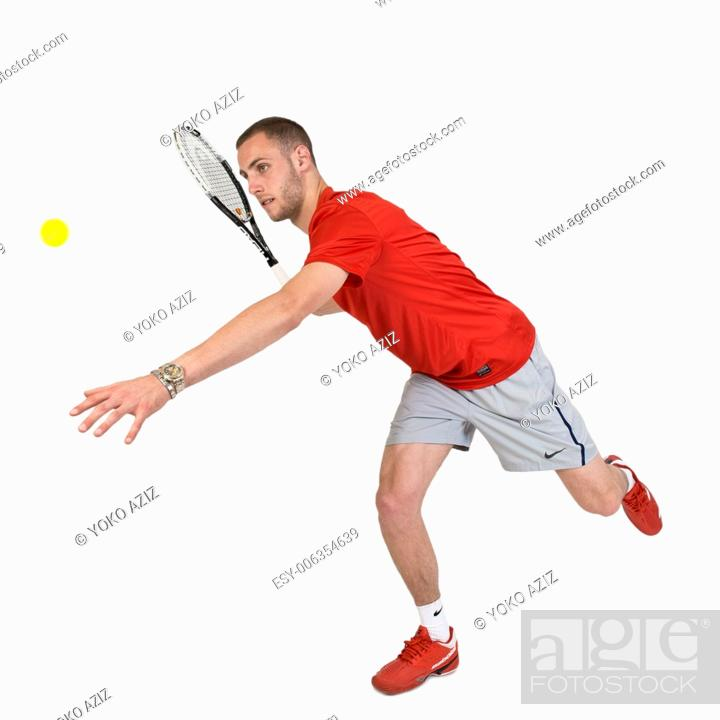 Stock Photo: Young man playing tennis.