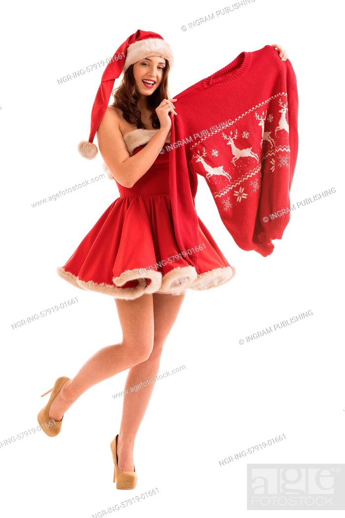 Stock Photo: Christmas woman holding woolen sweater with christmas deers.