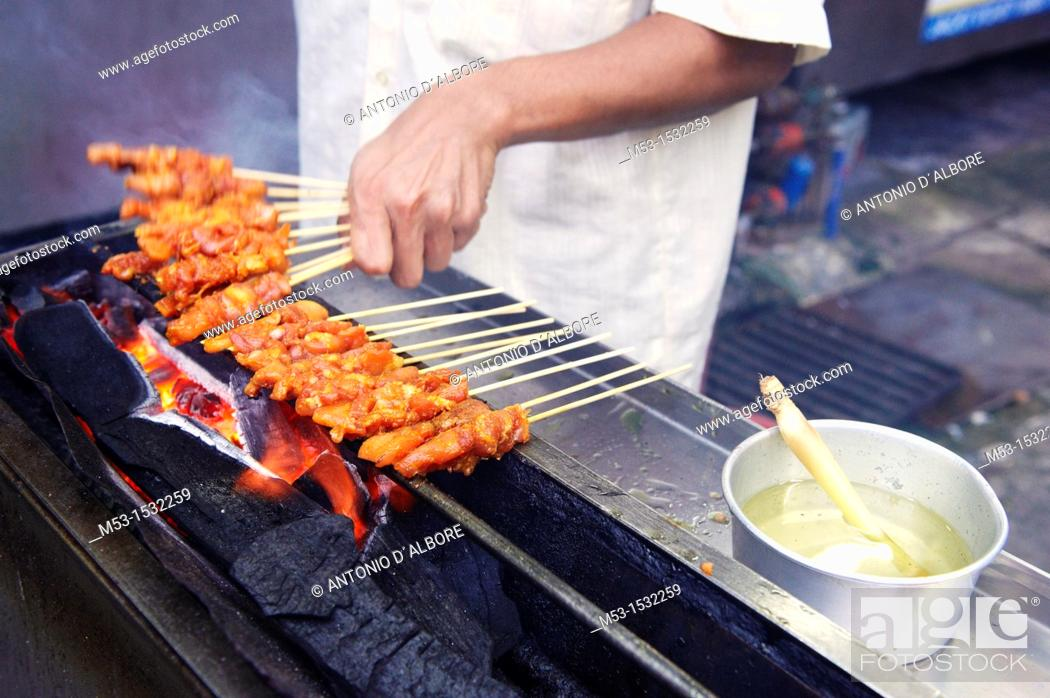 Stock Photo: Cooking chicken skewers on a charcoal grill  Kuala lumpur  Malaysia.