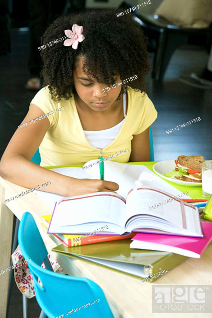 Stock Photo: Close-up of a girl doing her homework.