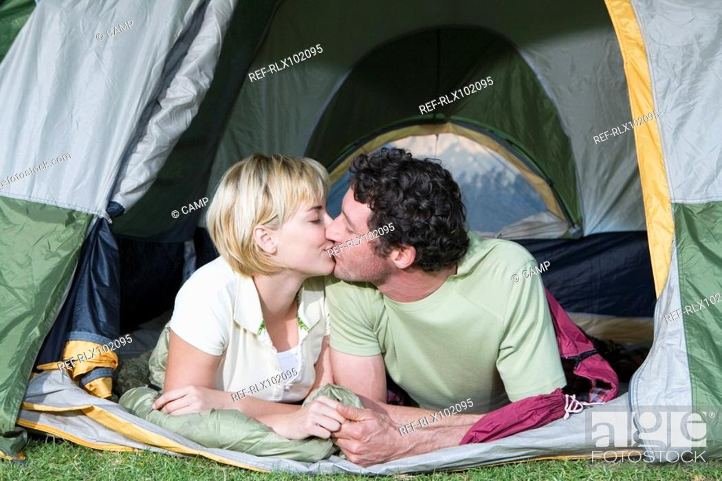 Stock Photo - Young couple in tent c&ing kissing  sc 1 st  Age Fotostock & Young couple in tent camping kissing Stock Photo Picture And ...