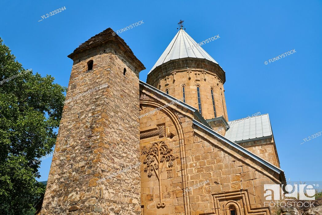 Stock Photo: Pictures & images of the Church of the Assumption built in 1689. and a a tower with a stepped pyramidal roof of Svanetian type.