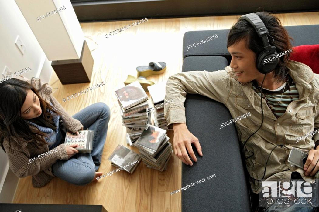 Stock Photo: Two people sitting inside room, high angle view.