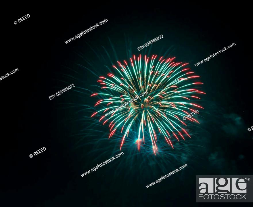 Stock Photo: Colorful fireworks in the night sky.