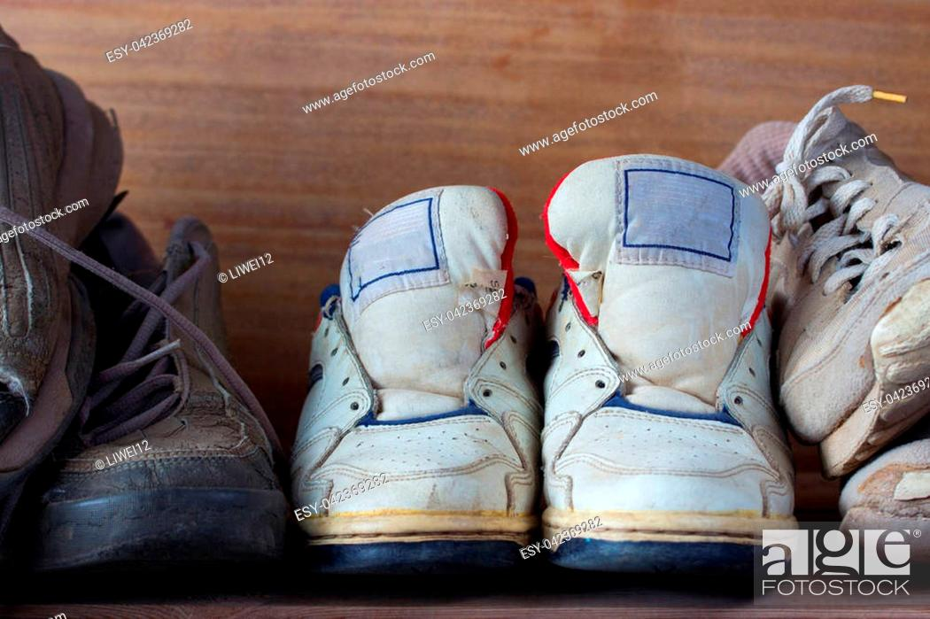Stock Photo: front view from the pairs of old boots.