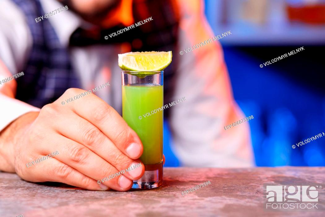 Stock Photo: The hand closeup of barman at work, he preparing cocktails. Concept about service and beverages.