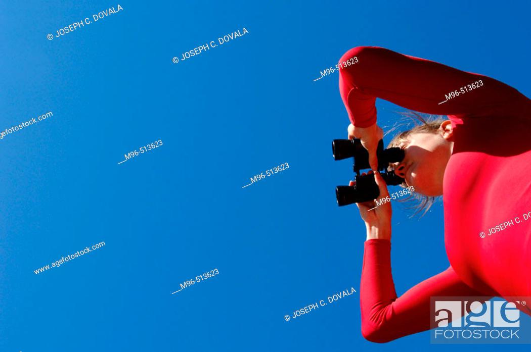 Stock Photo: Woman with  binoculars.