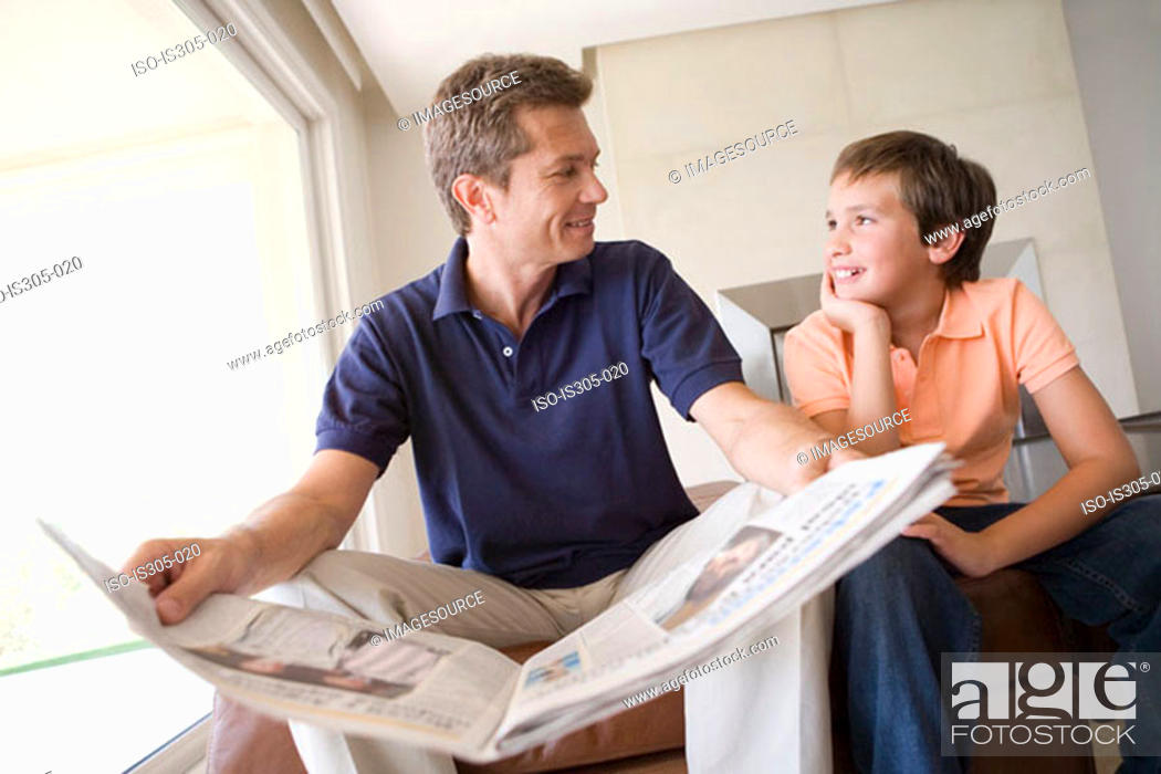 Stock Photo: Son and father with newspaper.