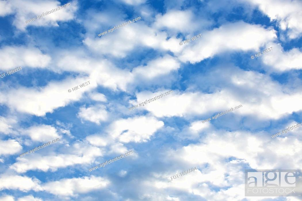 Stock Photo: Fluffy white clouds in sunny blue sky.