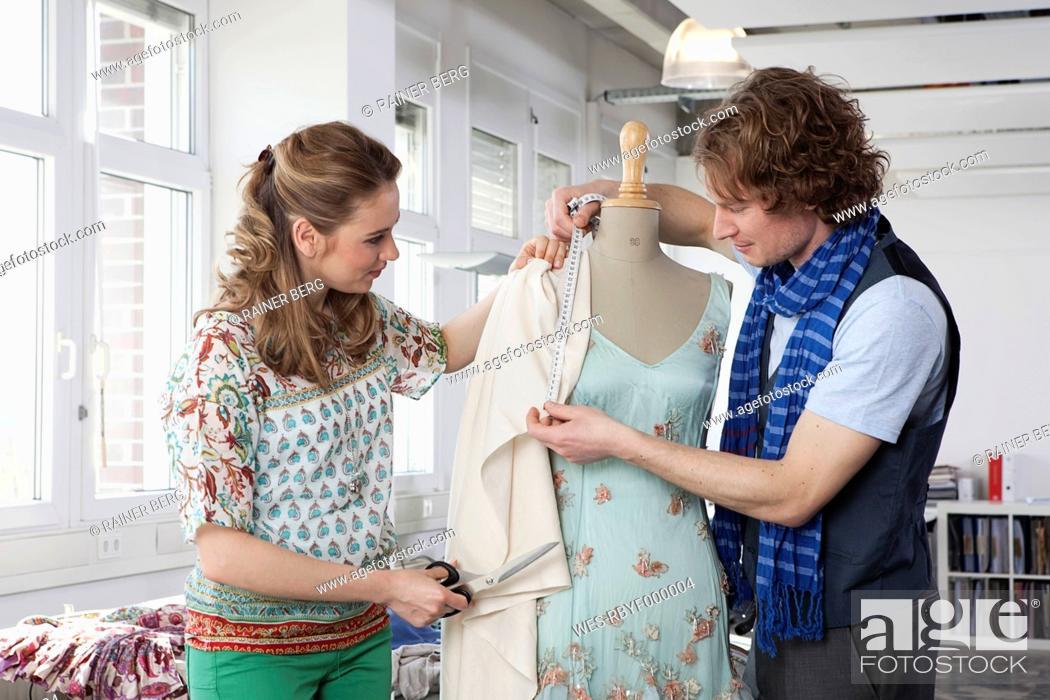 Stock Photo: Germany, Bavaria, Munich, Fashion designers working.