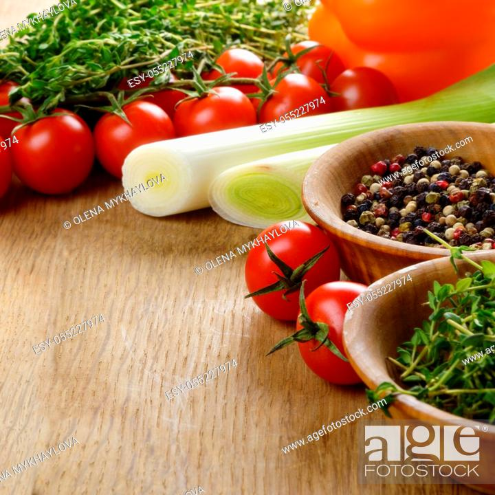 Stock Photo: Fresh Organic Vegetables and Spices on a Wooden Background with Space For Your Text.