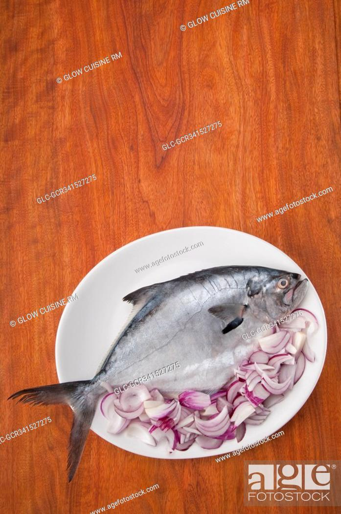 Stock Photo: High angle view of a fish with sliced onion.