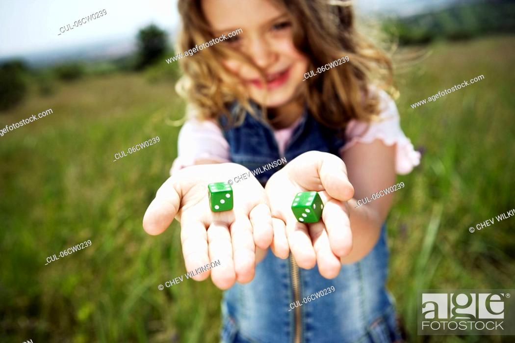 Stock Photo: Girl holding dice.