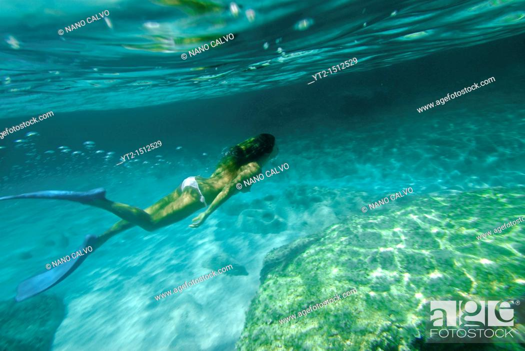Stock Photo: Amazing clear waters of Mitjorn, in the paradisiac island of Formentera   Formentera is the smallest and southernmost island of the Illes Pitiüses group which.
