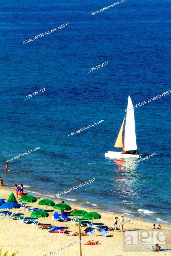 Stock Photo: Tourists in the Playa d'en Bossa, Playa d'en Bossa, Ibiza, Balearic Islands, Spain, Europe.