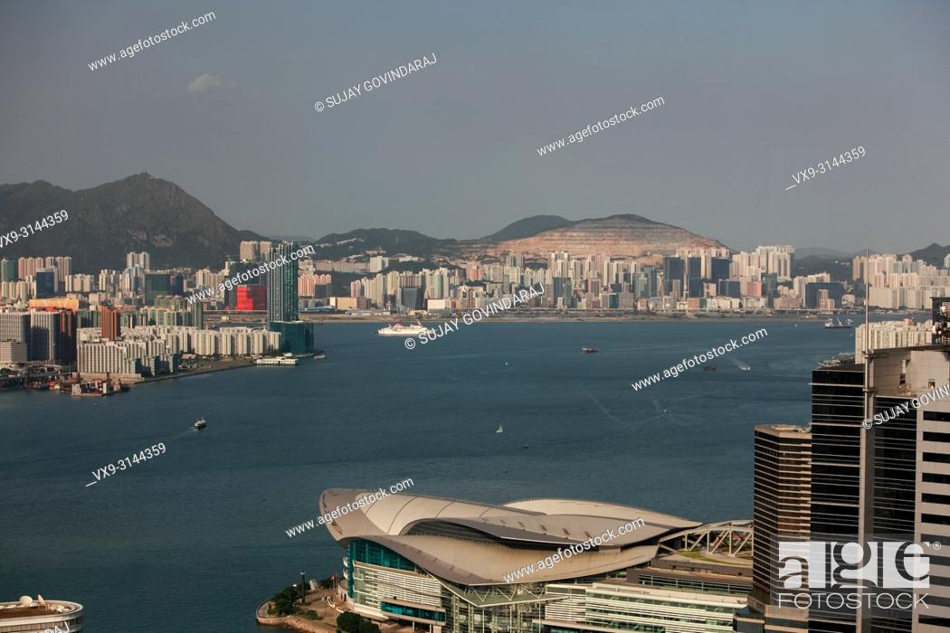 Stock Photo: Hong Kong, China - September 25, 2009: Wide view high rise towers, modern buildings and vessels on the sea in Hong Kong.
