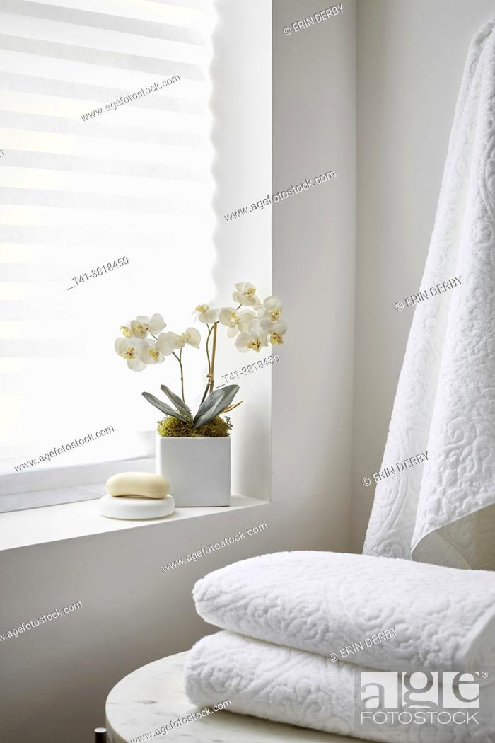 Stock Photo: A stack of white towels in a spa-like setting.